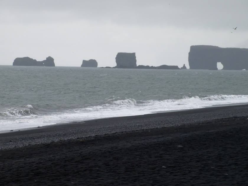 Black sand beaches as seen on the South Shore adventure.