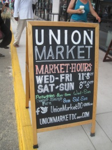 The sign outside an uber-crowded Union Market, luring you in.