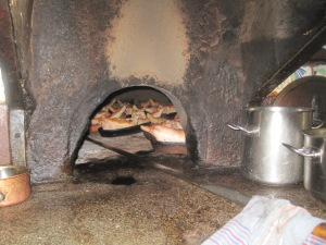 This original brick oven can be found in bison. Yes, those are real pigs.