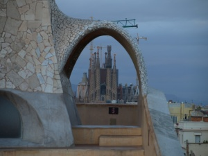 It took me 30 minutes to get this photo but I love it. Through one of Casa Mila's rooftop statues, you can see Sagrada Familia.