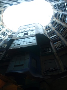 Standing in the courtyard at Casa Mila, looking up.