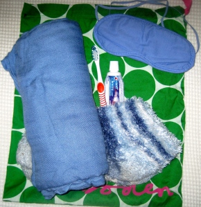 "Wondering what a ""sleep kit"" is? Wonder no more! It's my own blanket, socks, eye mask and tooth brush."